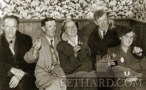 This happy group was photographed in the 1950s in Maureen Holohan's Pub in Burke Street. L to R: Paddy Ryan, Kerry Street; Dan and Mae Mullins, Knockbrack; Denis and Nora O'Meara, Knockbrack.