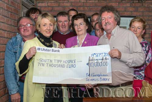 Matty Tynan, presenting a cheque for €10,000 to Phil Kehoe, Tipperary Hospice, proceeds of the Coolmoyne and Moyglass Vintage Club's silage extravaganza. Also included are Breda Ryan and Mary Morris from Tipperary Hospice, and organising commmittee members.