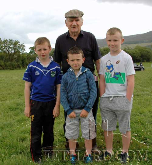 Jimmy O'Shea (back) photographed with his grand-nephews at Killusty Pony Show L to R: Jake Coen, Sam Coen and Matt Coen.