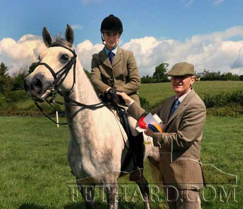 Luke Coen, Killusty, photographed on 'Ballinclough Master Card', being presented with his prize after winning Class 36, Best Connemara Pony to be ridden by rider under-16 years, at the KIllusty Pony Show.