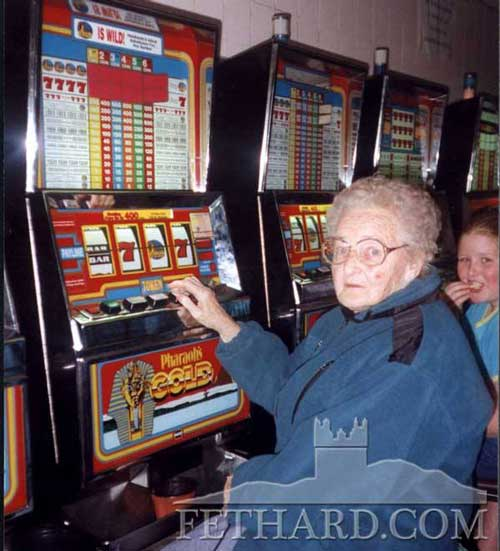Mrs Mary Slattery, Rocklow Road, having a flutter on the slot machines in Tramore back in 1999.
