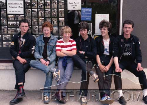 Sitting ouside a display of Fethard Festival Parade Photos in Kenny's shop window, July 1981, are L to R: Cyril Keane, Nigel O'Donnell, James Connolly, Paul Trehy, Pat O'Meara and Eddie Trehy.