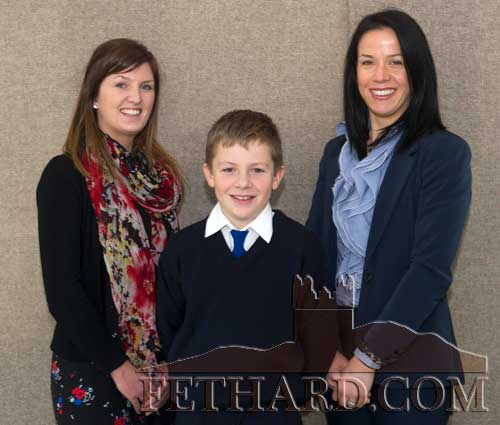 Shane Neville, a sixth class student from Holy Trinity National School in Fethard, who was awarded a full academic scholarship to attend Rockwell College, photographed with his teacher Ms Rebecca Meagher (left) and school Principal, Mrs Triona Morrisson.