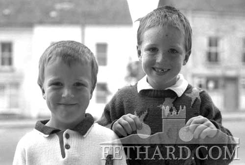 Emmet and Glen Burke holding medals for U6 and U8 running events at the Fethard Community Sports May 1989