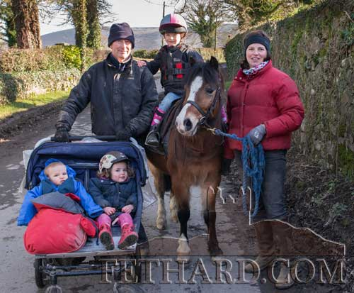Polly and Michael Creegan out for a family stroll with their children Elizabeth (on pony), Andrew and Annabella in pram.
