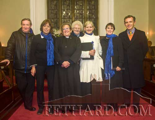Photographed at the Carol Service at Holy Trinity Church of Ireland, Fethard, on Sunday night last were L to R: Fr. Gerry Horan OSA, Shirley Clooney, Rev Canon Barbara Fryday, Agnes Evans, Geraldine McCarthy, Noreen Harrington and David Butler (organist).
