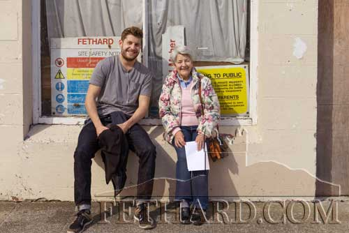 Matt O'Sullivan having a chat with his aunt, Mossie Hayes, on Fethard's Main Street during the recent sunshine.