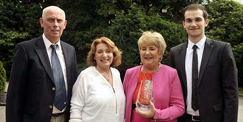 Madge Fogarty (right), winner of the Glanmire and District Sports, Business and Community award for August, photographed with Kathleen Lynch, her husband Joe (left) and her son Shane Fogarty at the award presentation held at Fitzgerald's Vienna Woods Hotel. (Picture: Mike English)