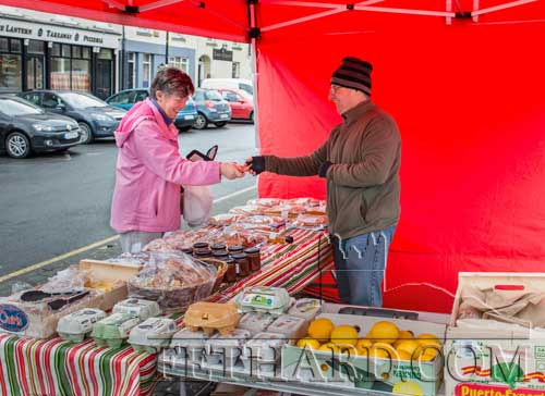 Popular street trader Willie O'Connell, Lisronagh, selling some of his fresh produce to Joan Allen from his market stall on The Square in Fethard on Thursday, March 24, 2016.