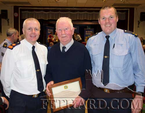 Photographed at the Garda Community Award presentation to Austin O'Flynn, Fethard, at Halla Na Féile, Cashel, are L to R: Superintendent William Leahy, Austin O'Flynn, and Garda Shane O'Neill, Fethard.