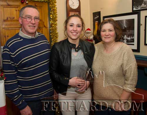 Aobh Ní Shé (centre) photographed with her parents Martin and Helena O'Shea at the Butler's Bar Sports Achievement Award presentation for December.