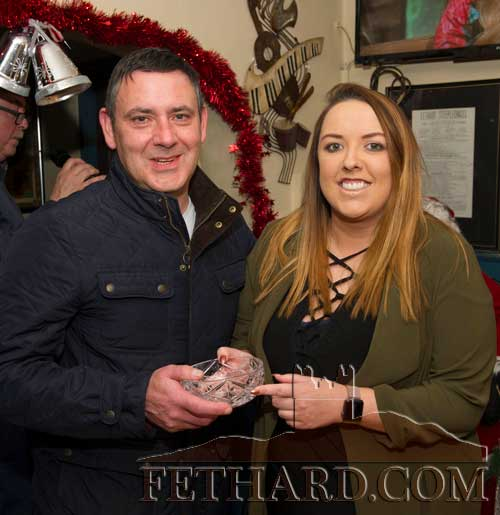 Ann Marie Butler presenting the Butler's Bar 'Mentor of the Month' Award for November to Kevin Coffey