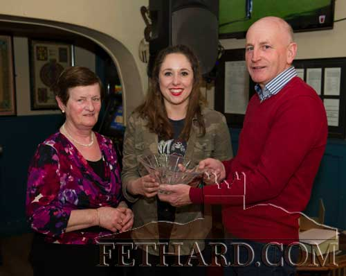 Michéal Maher, representing this month's sponsor, Maher Construction Fethard, presenting the Butler's Bar Sports Achievement Award presentation for March to winner Aobh Ní Shé (centre). Also included is Mary Godfrey from the award selection committee.