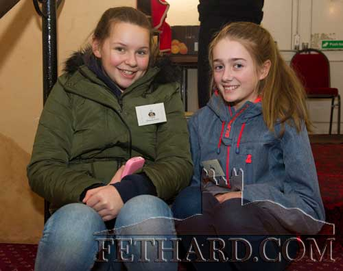 Having a rest on the ballroom steps at the Fethard Book Fair are L to R: Ella Hackett and Sadhbh Morrissey.