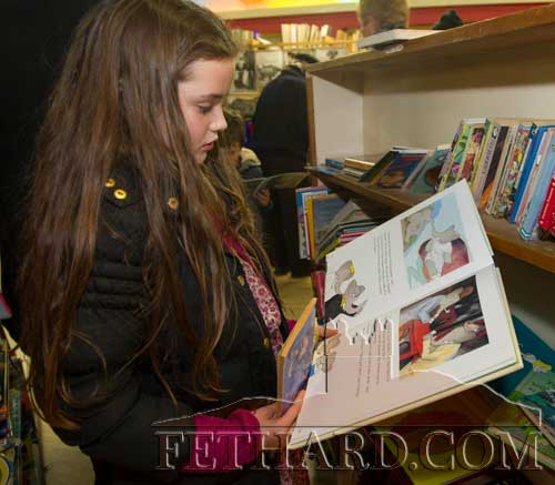 Róisín Tyrrell, Fethard, looking through the children's selection of books available at the Tipperariana Book Fair.