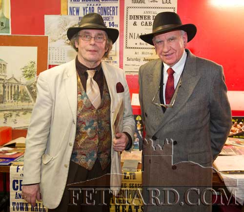 Dressed for the occasion at the Tipperariana Book Fair in Fethard Ballroom are L to R: Tom Muldowney and John Ryan.