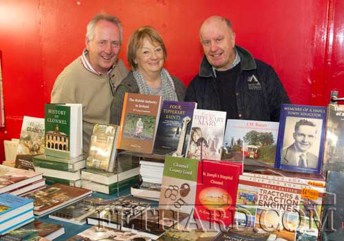 Photographed at the Tipperariana Book Fair in Fethard Ballroom are L to R: Denis O'Donovan, Rosie O'Donovan, and John Kenrick. Denis and John were former neighbours from Burke Street, Fethard.
