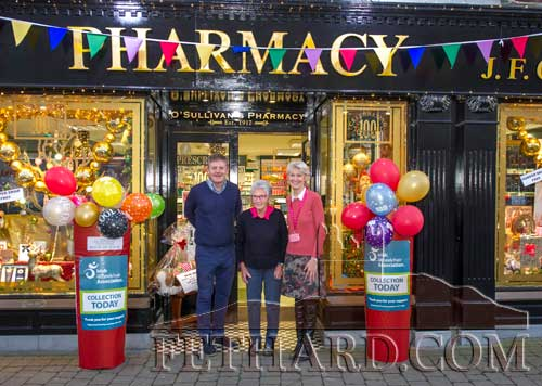 Proprietors Jimmy and Fionnuala O'Sullivan, photographed with Jimmy's mother Marie O'Sullivan, outside O'Sullivan's Pharmacy, Fethard, who are celebrating 100 years in business in Fethard. The shop first opened in October 1917.