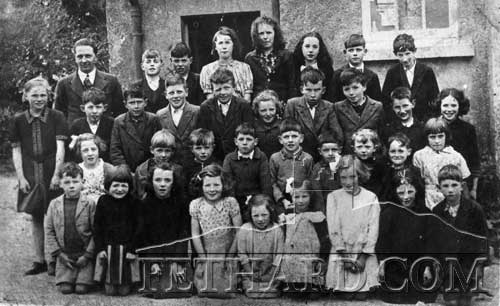 Coolmoyne National School c.1939. Back L to R: Mr. P. O'Dwyer (teacher and County Tipperary hurler), M. Hennessy, J. Treacy, Miss Treacy, Miss Wall, Miss Wall, P. Hennessy, T. Heffernan, 3rd Row: A. McCormack, J, Barry, S. O'Brien, W. Morrissey, J. O'Brien, J. Hogan, S. Moloney, D. Markley, P. Grant, M. Morrissey. 2nd Row: M. Barry, R. Maher, T. Treacy, M. Flanagan, M. McCormack, T. McCormack, M. O'Brien, A. O'Brien, M. Hennessy. Front: P. McCarthy, K. Fahey, A. Treacy, C. O'Brien, F. Hogan, J. Flanagan, M. Flanagan, W. Morrissey, M. Flanagan.