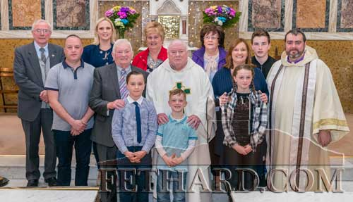Photographed at the Golden Jubilee Mass of Dr. Martin Crean's ordination to the Augustinian Order in Fethard on April 30, are family members Back L to R: Bro Kieran Loughran, Stephanie McNamara, Theresa Crean, Noreen Quinlivan, Sean Quinlivan, Fr. David Gibson (Limerick). Middle Row L to R: Alan McNamara, Jack Crean, Fr. Martin Crean OSA, Linda Quinlivan. Front L to R: Thomas, Niall and Louise McNamara.