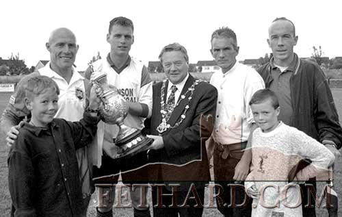Pictured at the benefit soccer match between Limerick F.C. and Clonmel played at the Dr. Pat O'Callaghan Sports Complex in Clonmel are L to R: young Paul Johnson and Limerick captain Dave Connell, showing off the Munster Senior Cup to Stephen Napier (Cork United) captain of the Clonmel selection, Alderman Tom Ambrose, Mayor of Clonmel, Ben Johnson, Charles and young Colin Johnson. Proceeds of the match were for the Johnson family, Bianconi Drive, who recently had their house accidentally destroyed by fire.