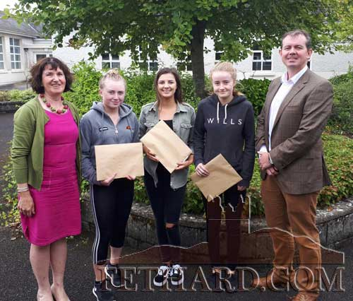School Principal Mr Michael O'Sullivan and Deputy Principal Ms Mary Ann Fogarty, photographed with Leaving Cert students after collecting their exam results. L to R: Ms Mary Ann Fogarty, Megan Coen, Ciara Hayes, Carrie Davey and Mr Michael O'Sullivan.