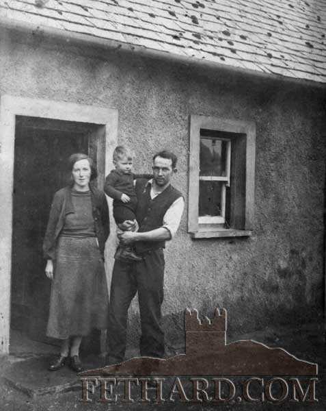 The late William Slattery, photographed as a child with his parents, James and Mary Slattery, outside their house on Rocklow Road, Fethard.