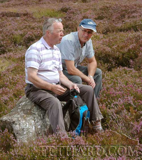 Michael Kenrick (left) and Noel Sharpe taking a rest on the pilgrimage to Holy Year Cross on Slievenamon