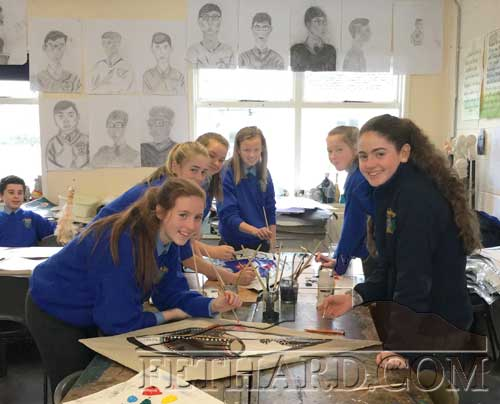 Patrician Presentation 2nd Year pupils photographed working on the masks used in Fethard Players 'Dancing at Lugnasa' production. From left, (in the background holding chicken) is Carlos Zapico Casido, Cheyenne McDonald Creed, Sadhbh Morrisey, Ella-Mai Hackett, Lauren Needham, Latacha Sheehan and Emma Lyons.