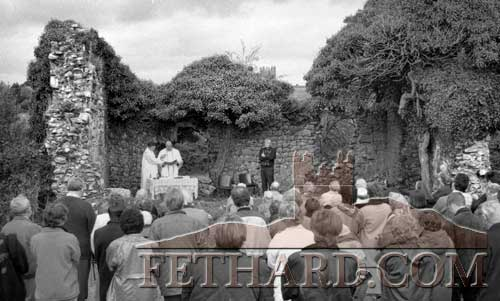 The late Canon James Power P.P. photographed saying Mass, assisted by Fr. Sean Ryan and Fr. Ben O'Brien OSA, after blessing a newly erected plaque erected in memory of all the infants buried in the grounds of Templemartin church ruins on October 6, 1996. The Mass was attended by over 150 people who showed their appreciation with a loud round of applause at the end.