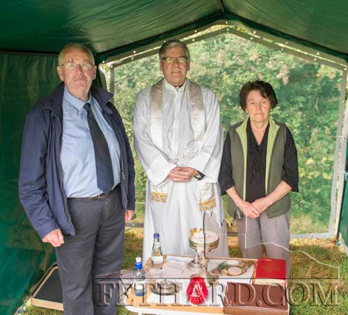 Photographed at the Cemetery Mass at Templemartin Church are L to R: Gus Fitzgerald, Canon Tom Breen P.P. and Mary Connors.