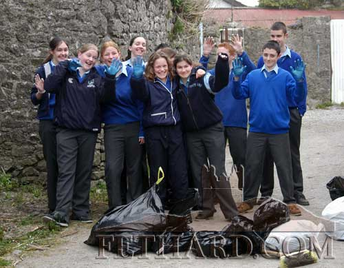 Students Cleanup on March 28, 2003 - Third Year pupils from Fethard Patrician Presentation Secondary School photographed while undertaking a 'cleanup' of Old Chapel Lane in Fethard. Old Chapel Lane is one of the oldest lanes in Fethard and is included in the Fethard Medieval Tourist Trail. The students must be commended for their civic minded project.