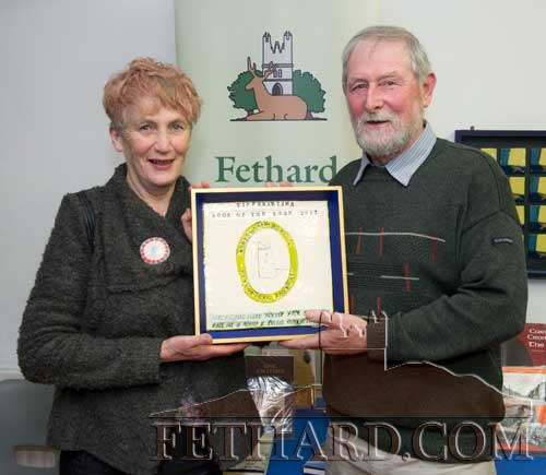 Local artist Dóirín Saurus, representing Fethard Historical Society's book fair committee, presenting the Tipperariana Book of the Year award for 2017 to Tom Ryan, chairman of the Boherlahan-Dualla Historical Journal committee, for their group's winning publication - Volume 20 of their annual 'Boherlahan-Dualla Historical Journal'.
