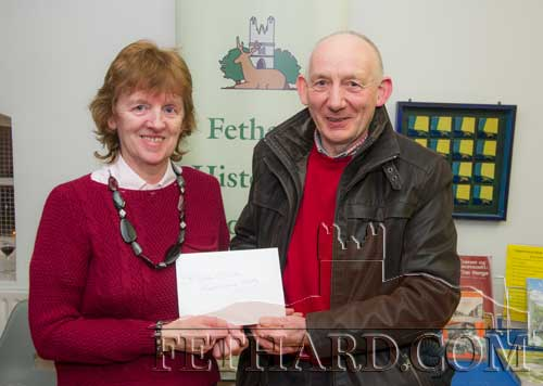 Catherine O'Flynn (Fethard Historical Society) presenting restaurant voucher to Paddy O'Dwyer (Boherlahan-Dualla Historical Journal editorial committee).