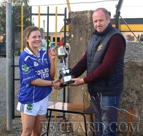 Fethard captain Lauren Dowling accepted the cup on behalf of her team mates from County Board Chairman, Lar Roche.