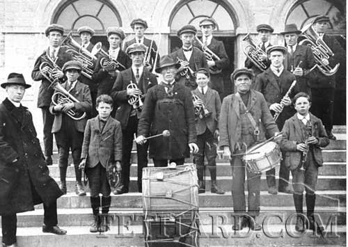 Fethard Confraternity Band in the early 1920s. Back L to R: Mickey Gunne, Billy Mackey, Mickey Casey, Mickey Conway, Tom Hickey, Jack Dwyer, Johnny Croke, Ned Cummins, Connie Fitzgerald. Middle L to R: Paddy Dwyer, John Sayers, Willie Weston, Mickey Hickey. Front L to R: Rev. Fr. Noonan, Mick Sheedy, Johnny Fitzgerald, Tommy Wall and Tom Sheehan.