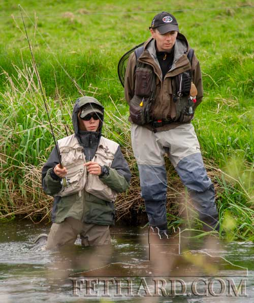 Robert Hackett (left), winner of this year's Fethard & Killusty Angling Club's junior competition, photographed with club secretary, Seán Maher, who was winner of this year's senior competition. Sean is photographed above while coaching Robert at the recent Munster Juvenile Fishing Tournament on the river Anner at Thorney Bridge, Fethard.