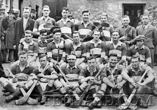 Would any of our hurling fans have any information on this hurling team photo, that I presume was a Tipperary team from the jerseys. The only helmets used in those days were bandages and caps as can be seen from the bloodied one on the player 3rd left in front. The hurleys also look the worst for wear . . . maybe they badly needed an active Tipperary Supporters Club to raise funds. Yet they won many All-Irelands!