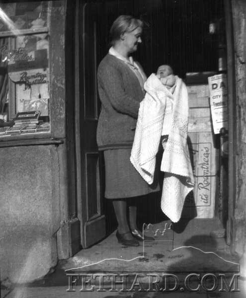 This photograph was taken outside Kenrick's shop in Burke Street with Rowntree's Pastilles, Fry's Valencia (Milk Chocolate with fruit and nuts), and bars of 'Plain York' on display in the window.