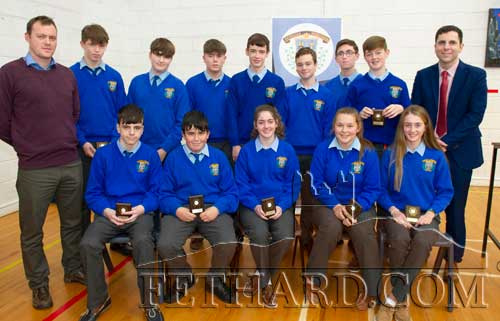 Mr Billy Walsh (back left) presented the 'Maths Eye Competition' winners with their awards: Michael Cuddihy, Michael O'Meara, Jack O'Donoghue, Tyler McCormack, Cian Lawrence, David Cowlard, Patrick Kennedy, Keenan Aherne, Sadhbh Morrissey, Emma Lyons, Ella-Mai Hackett and Simon Brawders. Also included is School Principal Mr Pat Coffey.