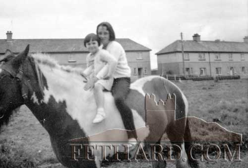 This photograph received from Sheila Dawson, Gloucester, England, shows herself (behind) and a young girl having a ride on a pony outside her Grandfather Stephen Dwyer's house in St Patricks Place.