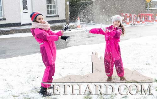 Erin and Keyla Carroll enjoying the snow in their new snowsuits