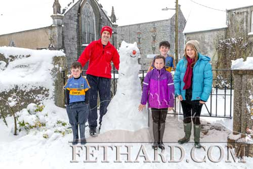 Paul and Niamh Hayes helping their children Anna, Danny and Billy, build their 'Snow Cat' outside their home in Abbey Street