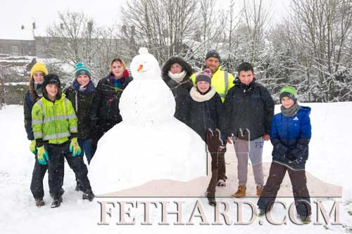 Members of the Thompson family and friends out enjoying a walk in the snow by the riverwalk in Fethard