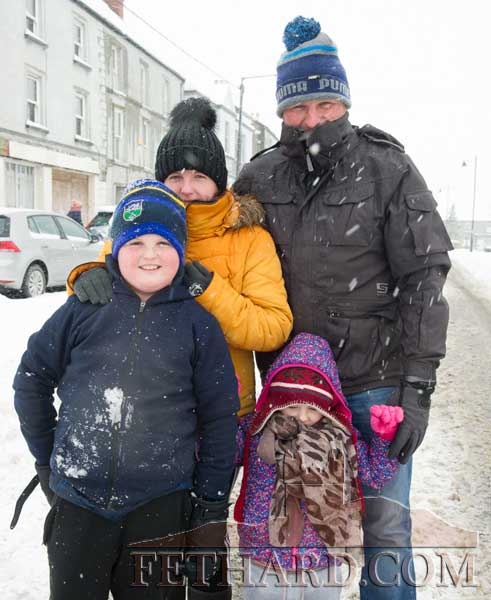 Well wrapped up for their walk in the snow are Tom Keane with Marcella Moyler and children T.J. and Zara Keane in front.