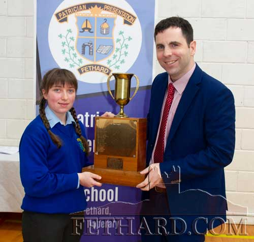 School Principal Mr Pat Coffey presenting the Padraig Pearse Perpetual Trophy (Best Junior Cert Results in Irish and History) to Rachel O'Loughnan.