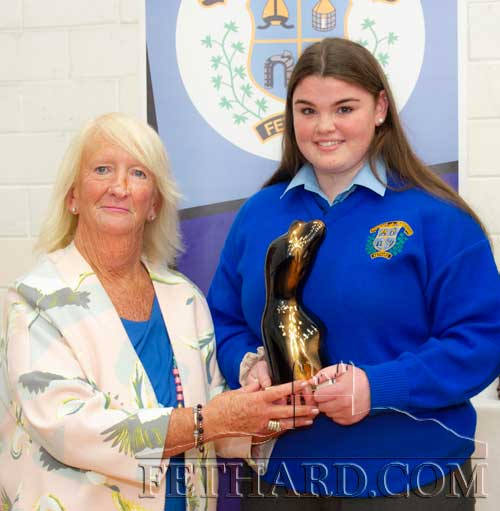 Ms Marian Gilpin presenting the LAM (Literature Arts & Music) Award to Caoimhe O'Meara.