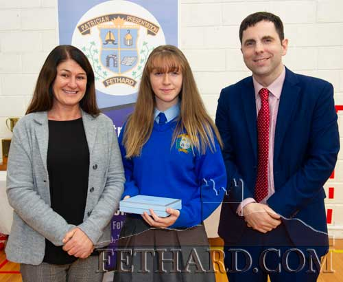 Ms Majella Whelan presenting the Fethard Quill Writer's Award to Anna Quigley (Junior Cycle). Also included is school principal Mr Pat Coffey.