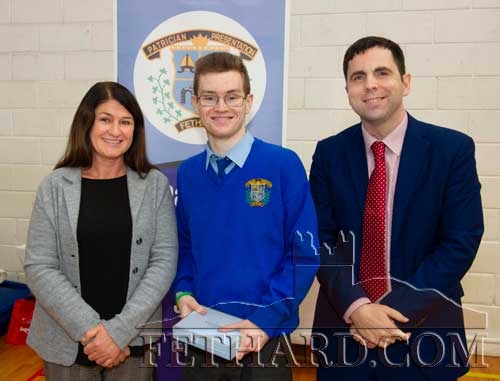 Ms Majella Whelan presenting the Fethard Quill Writer's Award to Aaron Trehy (Senior Cycle).  Also included is school principal Mr Pat Coffey.