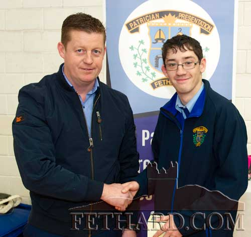 Mr John Cummins presenting the 'Materials Technology Award' to Patrick Shine.